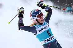 Mikaela Shiffrin raises her arms after crossing the finish line on her second run during the women's World Cup giant slalom skiing event, in Beaver Creek, Colo., Sunday, Dec. 1, 2013. Shiffrin finished second place. (AP Photo/Alessandro Trovati)