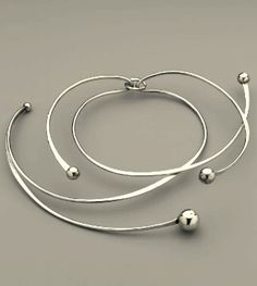Necklace by Art Smith. 1968. Sterling silver; forged, cast