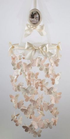 DIY Butterfly Mobile with White Lace, Pearls and Fabric.