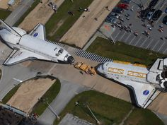 This is a sight that will probably never be seen again: two space shuttles nose-to-nose in the same location. NASA's space shuttles Endeavour and Atlantis switched locations today at Kennedy Space Center in Florida, and met each other for the last time in front of Orbiter Processing Facility 3