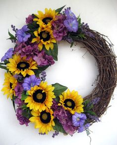 Vibrant summer silk grapevine wreath- I personally don't love the positioning of the flowers but I do love the flower types and colors, I would just re-arrange it for my taste.