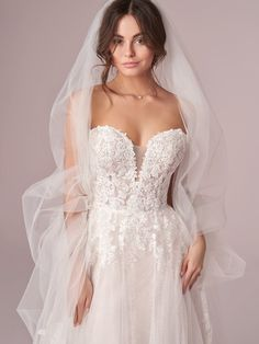25560 - Mavis by Rebecca Ingram. Try this beauty on at Aurora Bridal in Melbourne, FL 321-254-3880