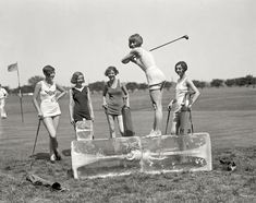 Women playing golf in bathing suits, 1926.
