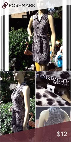 Animal print wrap dress Black and white animal print short sleeve wrap dress; great for travel; roll up I. Suitcase; dress up or down; excellent condition no rips or stains; fits a 6/8 Forwear Dresses Midi