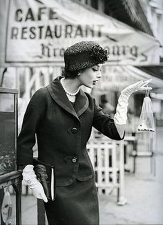 Marie-Helene Arnaud with a goldfish . Paris, 1957. by Georges Dambier.