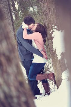 winter engagement-like the foot up on tree- would be cute if both were looking too