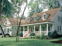 This is the color scheme: tan shingles, sage green siding, darker green shutters, and white trim.