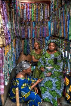 Textile sellers in Lagos Nigeria, busy with phones!