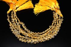 1strand  natural citrine faceted heart sized 5 by 5mm by 3yes