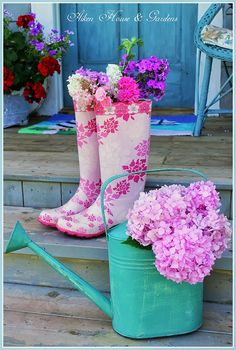 Flower arrangement in watering can and wellington boots