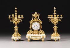 Jean-François and Guillaume Denière fl. 1820-1901<br>A Louis XVI style gilt bronze and white Carrara marble double sided three piece clock garniture, Paris, second half 19th century | Lot | Sotheby's