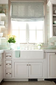 Kitchen with farmhouse sink <3 <3 <3 love th color of the backsplash maybe glass herringbone in this color