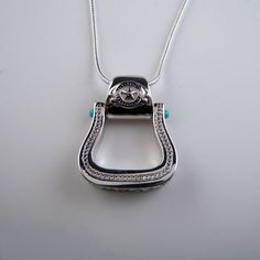 Western Culture! Ornate Western Stirrup Pendant in Sterling Silver. A piece of Western Horse Jewelry that has discrete bling. All the details in an understated Pendant Necklace that will blow you away