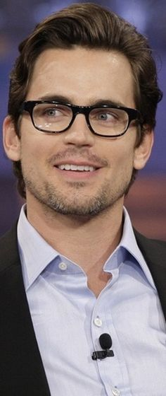 The glasses can't hide the cuteness that is Matt Bomer. :)