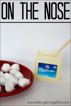 Minute to Win It: To move 5 cotton balls with your nose 8-10 feet across the room into a bowl, without using your hands.