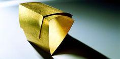 Giampaolo Babetto / Photograph Lorenzo Trento - Gold cuff.  Geometric, clean and simple, shape