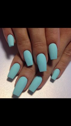 Soft turquoise acrylic matte nails.