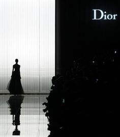 Classic yet a sense of drama is created at the Dior show as there is a play on scales & proportions, light & reflection & of course black
