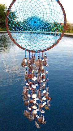Turquoise Sea Shell Dream Catcher. $25.00, via Etsy.