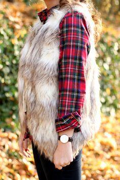 Layer a faux fur vest over a plaid shirt.