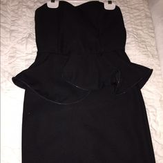 Windosr Dress Strapless. Tight fit. Peplum type fit toward middle. Great for going out and semi formal events. WINDSOR Dresses