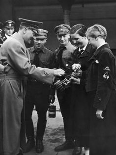 Hitler Youth members receive a charitable contribution to the Nazi Party's Winter Relief charity (to provide food, clothing, and the like for the less fortunate) from Adolf Hitler in Berlin, circa 1935.