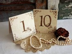 A string of pearls and a doily can make anything vintage.  Add table numbers and some flowers - centerpiece done.