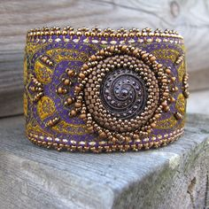 Purple Embroidered Cuff with Glass Button and Gold Beadwork  by sylviawindhurst, via Flickr