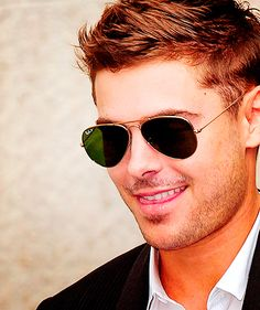 Zac Efron as smirking Christian Grey