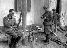 German soldiers clean and service captured Russian sub-machine guns - highly sought after for their ruggedness and setting to fire single shots, 1942.