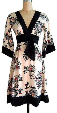 Kimono Dress in Cinnabar, heavy weight silk crepe de chine, Winter 2009, 2-14, $253 https://web.archive.org/web/20090301042351/http://trashydiva.com/trashydiva/KIMONODRESSCINNABAR.html