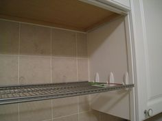 Hanging a shelf using Command hooks. Be creative when using inventive products  http://www.examiner.com/slideshow/no-tool-decorating-to-command-a-beautiful-abode#slide=1