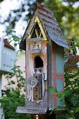 Decorate a Fence With Birdhouses