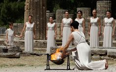 Greek actress Ino Menegaki, playing the role of High Priestess, lights a torch from the sun's rays reflected in a parabolic mirror during the torch lighting ceremony of the London 2012 Olympic Games at the site of ancient Olympia in Greece  Picture: REUTERS/John Kolesidis