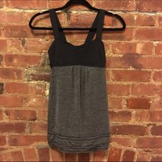 LULULEMON baby doll tank LULULEMON baby doll tank. Built in bra with cut outs on the side. Flowy. Perfect condition except that the size tag is missing. It's a size 2.  Trades lululemon athletica Tops Tank Tops
