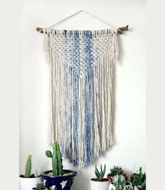 macrame wall hanging can hang & decor your walls and give your home awarm feeling. this macrame wall art is made of natural cotton cord,natural wood and hand dyed cotton cord in blue. this modern macrame gives your room warm feeling, you can hang it in your badroom,living room or any other room.  ^^^^^^^^  Wooden dowel length- 50cm (20 inches ) Macrame width-38 cm ( 15 inches ) Macrame length- 70cm ( 27 inches)  ^^^^^^^^ You want it bigger? smaller? other color? Because the macrame wall h...
