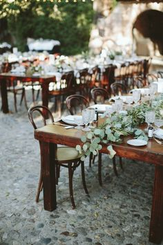 wooden harvest tables with greenery garland centrepiece for out door wedding reception | casually elegant rustic wedding at Hummingbird Ranch | neutral wedding