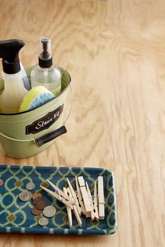 Label buckets designated for cleaning and use decorative catchall trays to keep your kitchen and laundry room tidy.