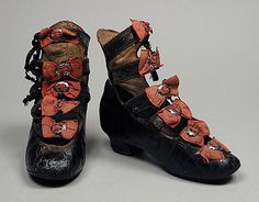 Little girl's open front boots decorated with bows, circa 1880.
