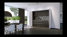 """This is """"HAWA-Folding Concepta 25 & HAWA-Concepta by Hawa Sliding Solutions AG on Vimeo, the home for high quality videos and the people… Sliding Cabinet Doors, Living Room Divider, Hidden Kitchen, Modern Kitchen Cabinets, Kitchen Furniture, Unusual Homes, Living Room Kitchen, Small Rooms, Building A House"""