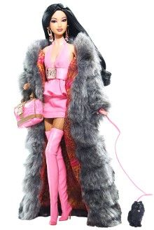 This one was by Kimora Lee Simmons in 2008 which resembles her even down to the dog...Barbie Designers - View Collectible Barbie Dolls By Famous Designers   Barbie Collector