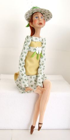 Sculpted clay and cloth handmade doll