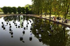 Alex Vermeulen's Floating Solar Panel Installation in Eindhoven is Designed To Lift a Levitating Buddha