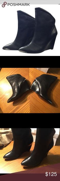 NIB Belle by Sigerson Morrison 6611 Black Boots Never worn black leather Sigerson Morrison boots. Very rock n roll with silver details on the toe and heel. Hard to find and come from a smoke free home Belle by Sigerson Morrison Shoes Ankle Boots & Booties