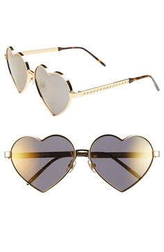 Adding bold flair to sunny days with these heart shaped sunnies that will be the perfect accessory for festival season.