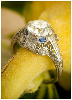 A 2.06 carat antique Art Deco engagement ring with filigree and sapphire details. Circa 1920.