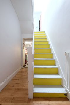 Fritha stripped the carpet off the stairs and had it painted bright yellow. The paint on the stairs is Dulux Goose Down Grey and Lemon Punch.