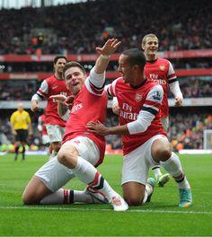 Olivier Giroud celebrates scoring the 3rd Arsenal goal with Theo Walcott (45) Arsenal 3-1 Tottenham Hotspur (November 2012)