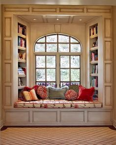 A great, cozy reading space. Lush coloured cushions compliment the simplicity of the room.