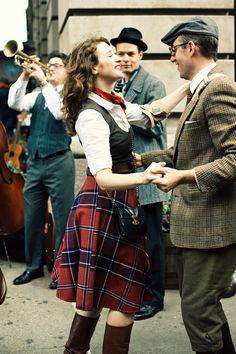 Her outfit- love the plaid skirt!